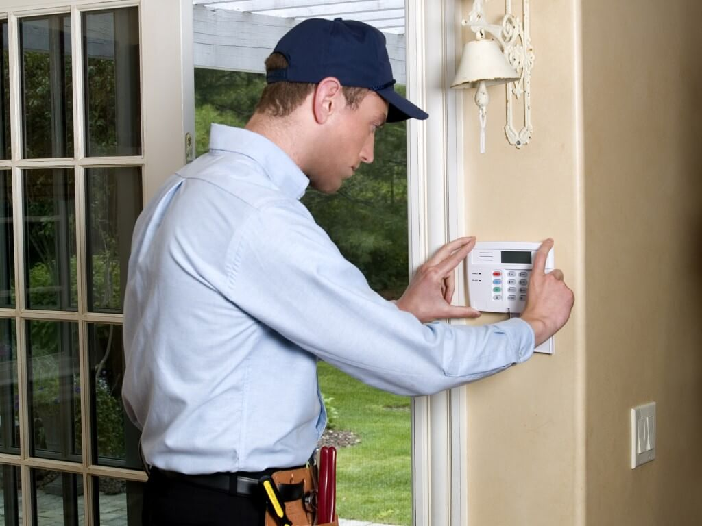 Technician installing a keypad - Home Security Systems