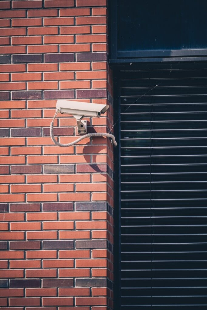 security camera on a brick buliding - Enterprise security systems