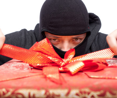 Thief opening a Christmas present